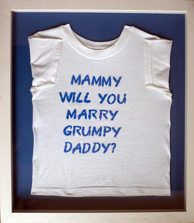 The custom T-shirt her fiancé Kevin had made for their son Caleb to wear during his proposal.