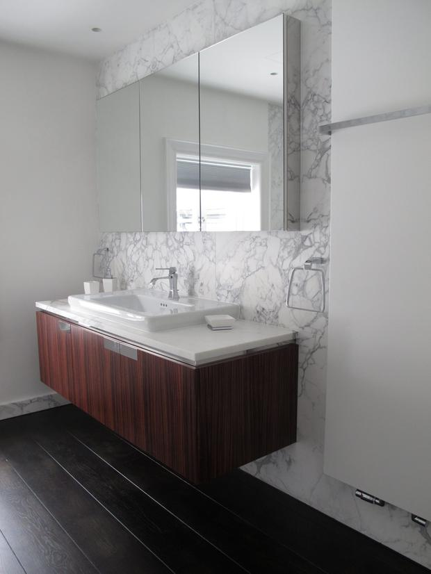 With a family bathroom, focus should be given to the vanity area and counter space, storage and laundry options
