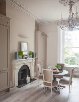 A new bespoke kitchen with hand-painted finish, made by the designers' own joinery, was created as part of the formal dining room.