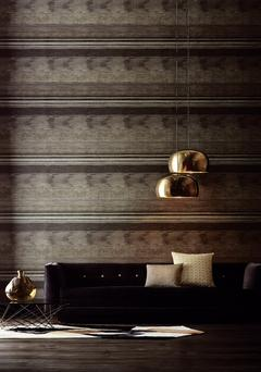 Pendant lighting creates warmth and intimacy in high-ceilinged rooms. Here, it highlights the striking Anthology wallpaper, which is known for its subtle textures and complex backgrounds. kevinkellyinteriors.ie