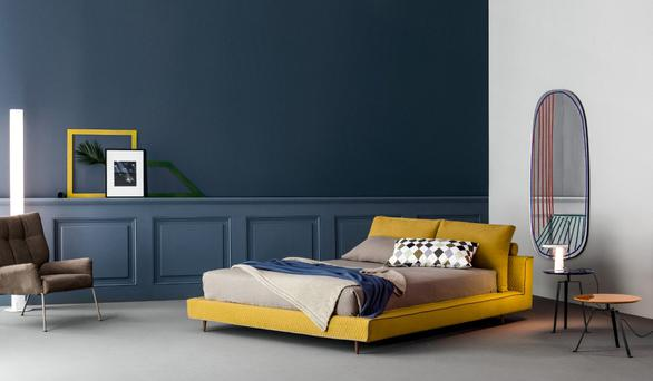 This Owen Ego bed frame from Lomi Design (€2,848 for a standard double) by Bonaldo of Italy is upholstered in a huge range of quilted fabrics, such as this mustard yellow