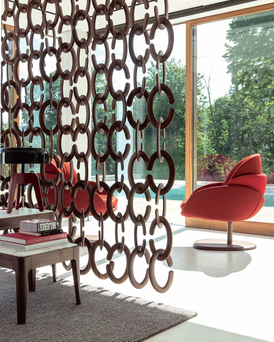 The COZY hanging room divider designed by T Colzani retains an open-plan feel but defines the separate areas; Lomi.ie