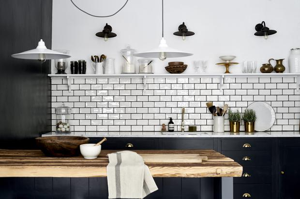 KITCHEN WONDER Neptune's beautiful Suffolk kitchen range, which features carved oak shelves, magnetic close system and concealed dimmable lighting, starts at €12,500. The black grouting looks seriously chic against the brickwork tiles; www.neptune.com.