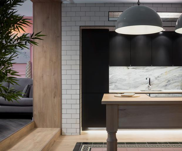 Strong, dark colours combined with marble and natural materials create a real wow factor in this kitchen designed by Kingston Lafferty.