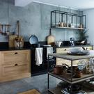 Two coffee tables are stacked to make a central island, while side tables are hung upside-down to make slick shelving in Neptune's Henley kitchen; neptune.com