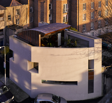 The exterior shows the curved nature of the site;