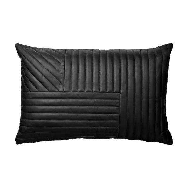 Motum leather black cushion, €157.85. Pay homage to the trend — and winter — by teaming new accessories with your existing décor for an easy season transition; aprilandthebear.com Pic: Christian B, Yellows