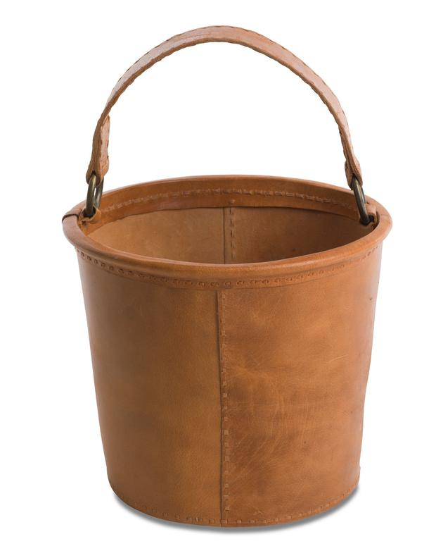 Kindling bucket, €102. Easy to wipe clean and hard-wearing, leather accessories for tough jobs are guaranteed to be long-lasting; decoratorsnotebook.co.uk