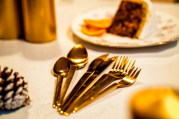 Gold coloured cutlery, from €1.24 at sostrenegrene.com; Christmas cake by Avoca.