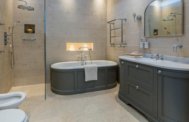 Victorian and Edwardian era brass fixtures and fittings, stand-alone tubs and chequered floor tiles are right back on our radar now, and we've also seen Art Deco return to the mix. This Heritage-style bathroom from Tilestyle ticks many of the boxes with traditional fittings, and a freestanding bathtub, but updated in slate grey. Bath, €2,659 (includes panelling but excludes taps), vanity unit, €4,062 (excludes taps), shower, €1,186, mirror lights, €258 each, €441, mirror, €316uscany honed natural stone tiles reduced from €141 to €97 per sqm; all at tilestyle.ie.