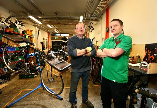 Noel Barbour and Robert Heary in the cycle workshop. Photo: Frank Mc Grath