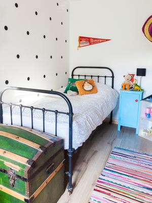 Interior architect Cathy O'Donoghue of Flamingo Interior Design revamped her Cork bungalow with upcycled, home-made or vintage furniture including her daughter Nancy's bed which was sourced on Donedeal
