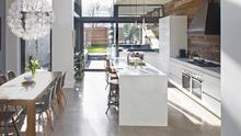 """LIGHT HOUSE This open-plan kitchen, which includes a split-level kitchen and dining space to the rear of the house, was created by Optimise Design for a young family who were returning to Ireland having lived in London for many years. """"The most challenging part of the project was to bring light deep into the central part of the house,"""" says Denise O'Connor of Optimise. """"To overcome this we designed a bespoke roof light running the length of the extension and an internal patio area opening into the living room area."""""""