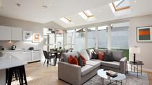 The open-plan kitchen/living room with skylights