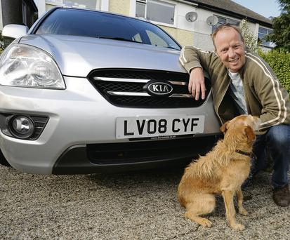Miles better: Simon Bradshaw with his new car, a Kia Carens diesel automatic, imported from the UK Dave Meehan