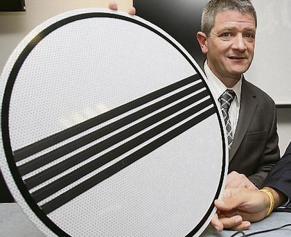 AA Ireland's Conor Faughnan with one of the new signs.