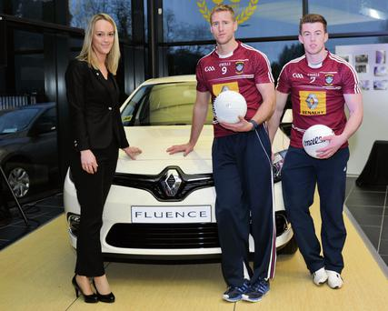 Lynne Boucher, marketing manager Renault group, with footballers Denis Glennon and Ger Egan.