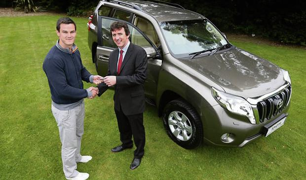 Steve Tormey of Toyota Ireland with rugby star Jonathan Sexton earlier this year. Photo: Cathal Noonan/Inpho