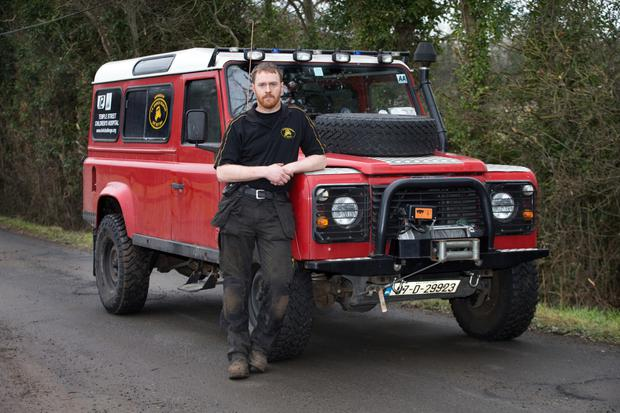 CLASSIC DESIGN: 'They are the most versatile vehicles in the world,' says Land Rover Defender owner David Feely, pictured with his 110 model. David has been working on Land Rovers for over 14 years. Photo: Tony Gavin
