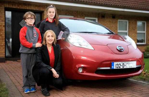 Elayne Devlin with her children Ethan and Ava alongside their Nissan LEAF Photo: Gerry Mooney