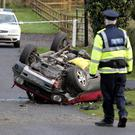 WASTED LIVES: A garda attending the scene of a serious road accident