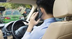 Man driving while talking on phone