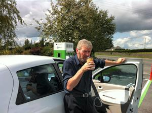 Eddie Cunningham stops to charge the Renault Zoe
