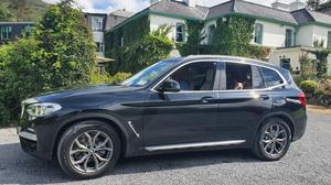 The BMW X3, complete with Ziggy the Jack Russell terrier,in the car park of Cashel House Hotel
