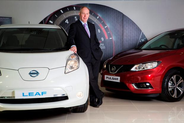Future vision: Nissan Ireland CEO James McCarthy pictured with a Nissan Leaf
