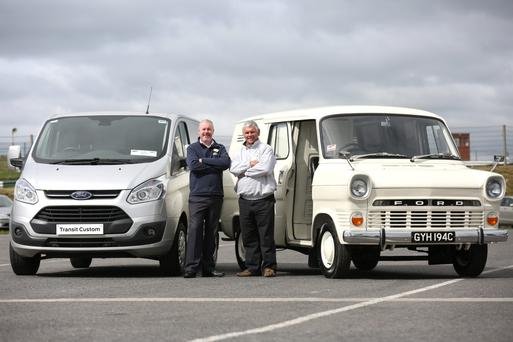 Ciarán McMahon, chairman and managing director Ford Ireland with Peter Lee, chairman of the UK Transit Owners Club, with a new Transit and a 1965 model.