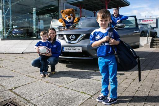 Leinster rugby fans who book a car service with the Windsor Motor Group will be rewarded with free fuel and Leinster Kit Bags. Picture are: Ciaran Mallon and Ruth Derwin with their sons Fionan (5) and Senan Mallon (3).