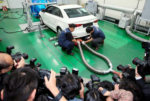 Technicians conduct an emissions test on an Audi vehicle at the National Institute of Environmental Research Transport Institute in South Korea as part of the worldwide investigation into VW engines