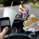 A driver can spend up to a third of a typical trip distracted.