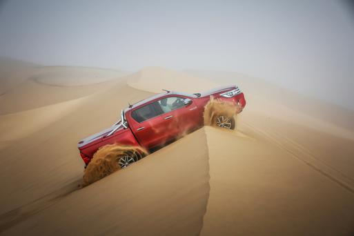 The Toyota Hilux being put through tests in the desert.