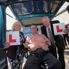 Padraic with Irish Wheelchair Association chief executive Rosemary Keogh and his IWA driving instructor Barry Reid at the unveiling of the new hi-tech vehicle.
