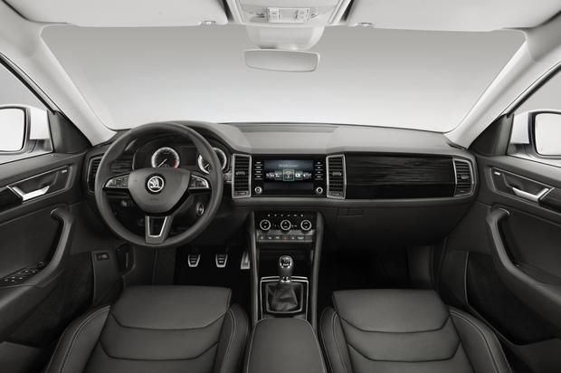 The instrument panel is fully visible through the large steering wheel