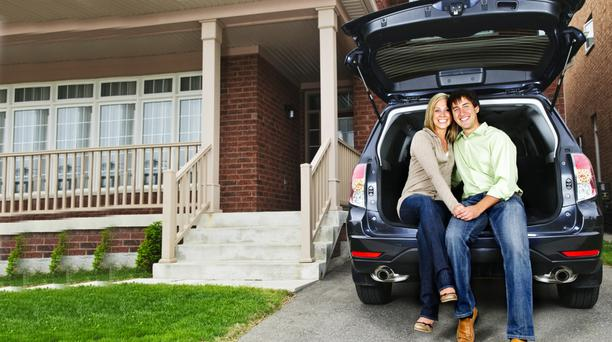 Couple with new SUV
