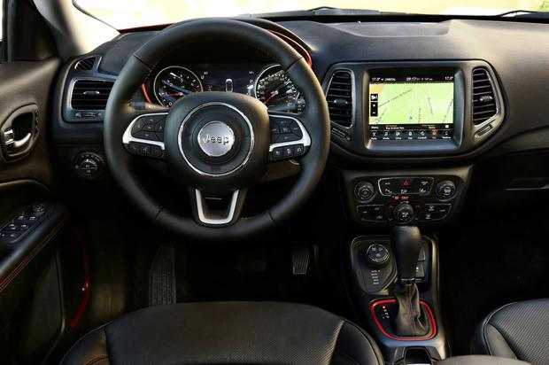 The interior is dominated by a new Uconnect infotainment system
