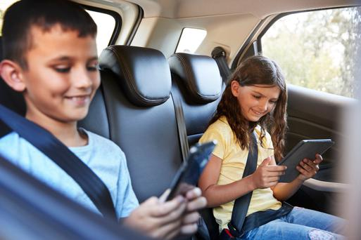 One-in-three say the children play on tablets during a car journey
