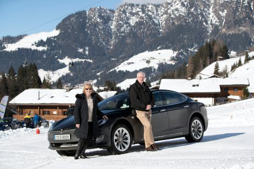 Brian Byrne with co-driver Trish Whelan and Tesla Model S