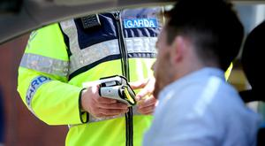 A garda carrying out a breath test (Stock photo)