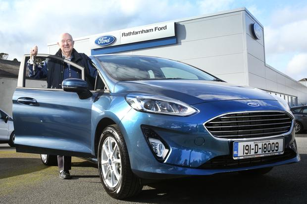 Templeogue native William Magahan, who turns 90 this year, with the keys of his 191 Ford Fiesta at Rathfarnham Ford's new showrooms in Whitechurch Road