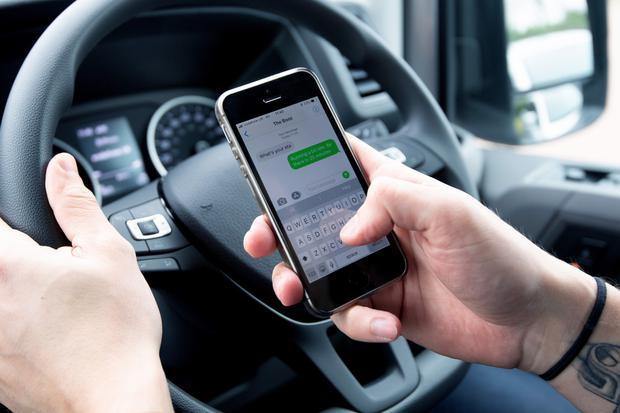 Driving while using mobile