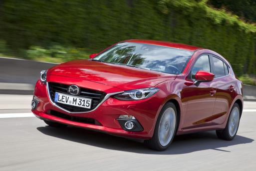 Edgy design: The Mazda3 has good looks, luxury and flair but space at the back is tight