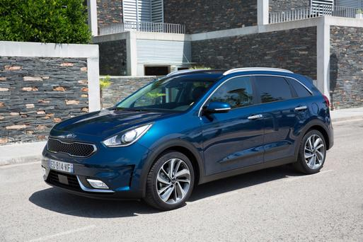 FRUGAL: Niro hybrid, left, is the first for Kia in the eco-friendly range