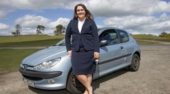 New driver Vanessa Ward with her car on the Curragh, Co Kildare