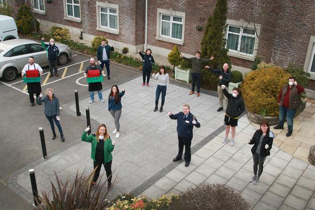 A helping hand: Volunteers social distance before delivering hot meals to people in need during Covid-19 pandemic at the Ashdown Park Hotel in Gorey. Co Wexford.