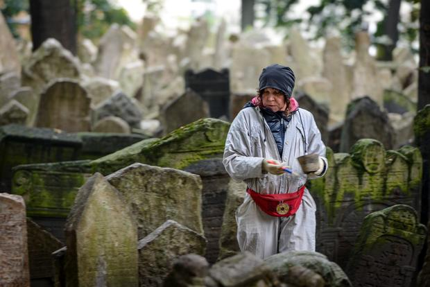 A restoration worker at The Jewish Cemetery in Prague. Photo: Getty