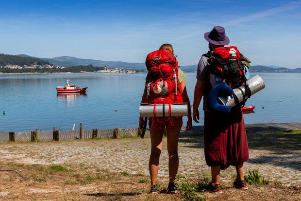 Two pilgrims look at the Miño river in Caminha, Portugal. Photo by Xurxo Lobato/Getty Images