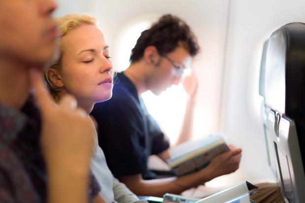 What's the best way to sleep on a plane? Photo: Deposit